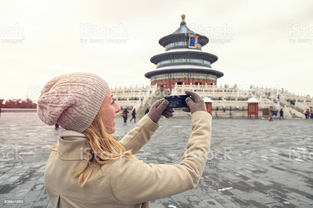 Tourist taking smart phone picture of Temple of Heaven,Beijing stock photo