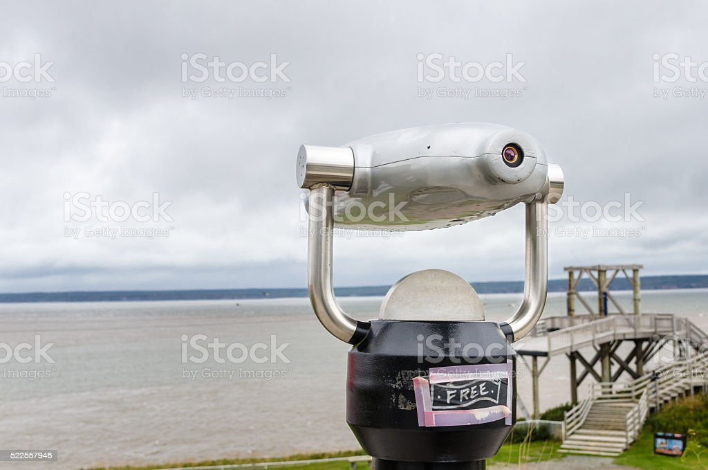 Close-up of a tourist telescope on the coast of the Bay of Fundy in...
