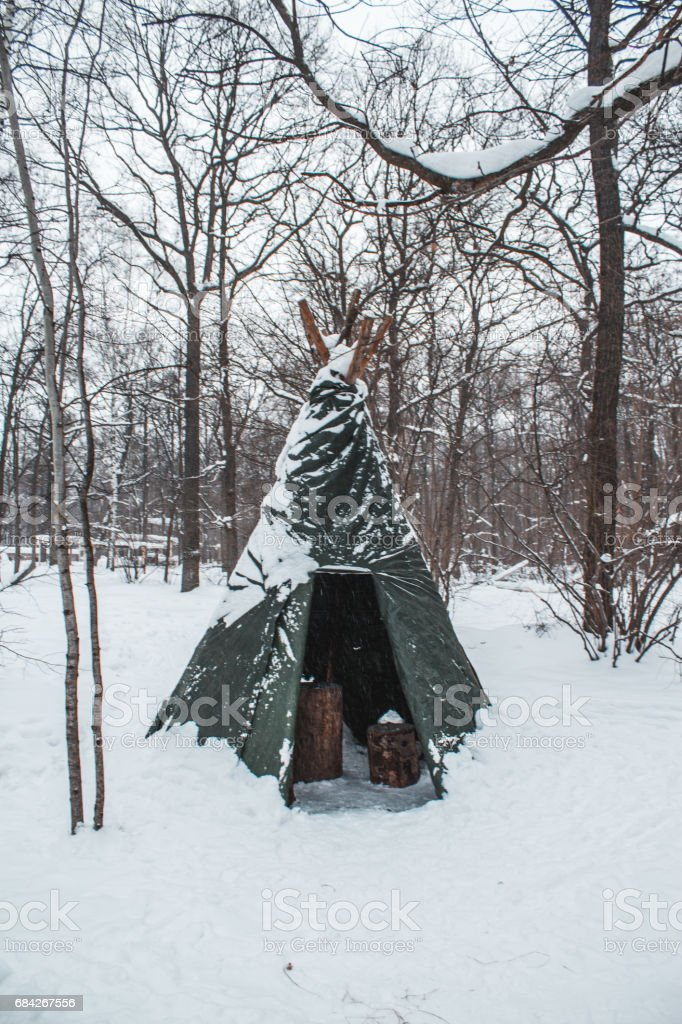 Tourist tent set in a winter snowy field stock photo