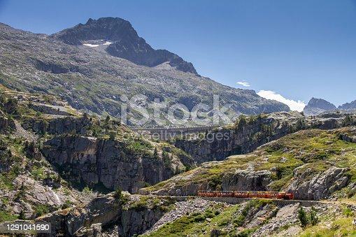 istock tourist train running through a mountain gorge in the Pyrenees, Artouste France 1291041590