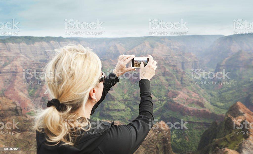 Tourist Traveling the Waimea Canyon of Kauai Hawaii Hz stock photo