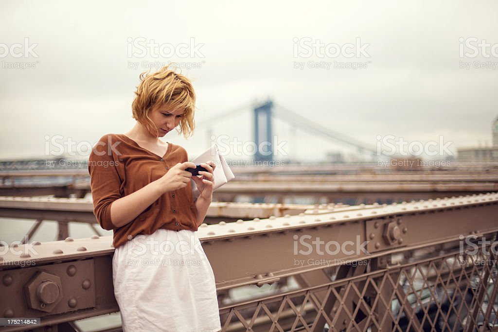 Tourist using a smartphone royalty-free stock photo
