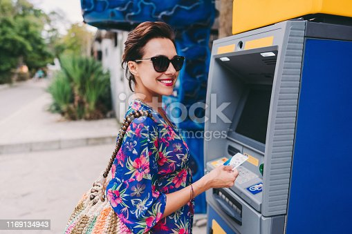istock Tourist using credit card on the ATM 1169134943