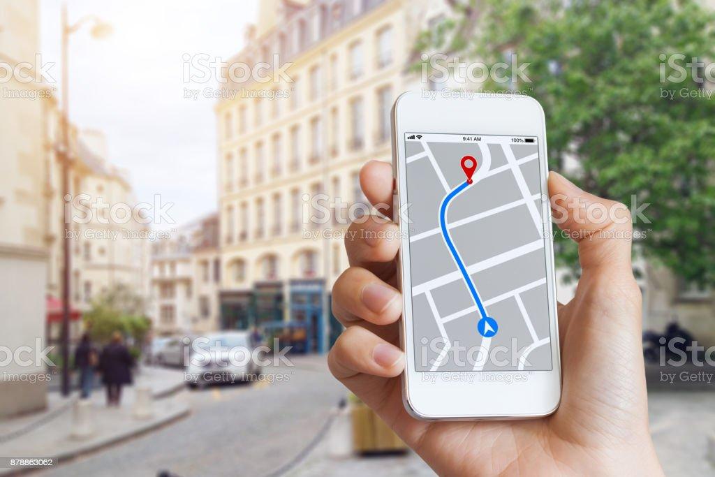 Tourist using GPS map navigation app on smartphone screen, direction stock photo