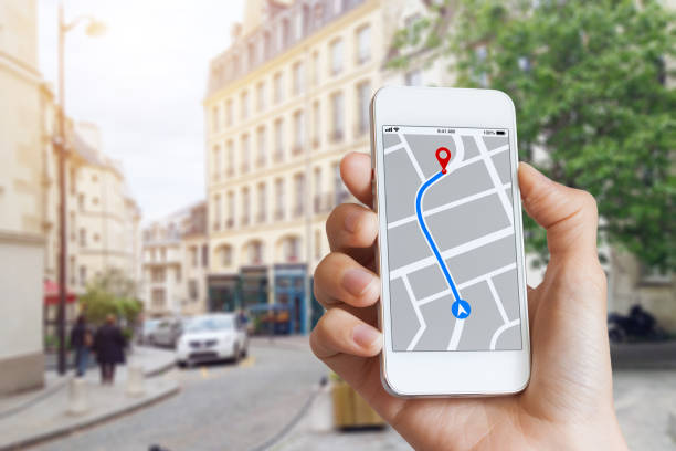 Tourist using GPS map navigation app on smartphone screen, direction Tourist using GPS map navigation app on smartphone screen to get direction to destination address in the city streets, travel and technology global positioning system stock pictures, royalty-free photos & images