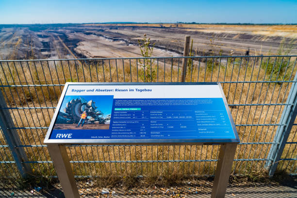 tourist viewpoint at an open mine in germany HOCHNEUKIRCH, GERMANY - JULY 7, 2018: Information shield at the Garzweiler brown coal mine tagebau stock pictures, royalty-free photos & images