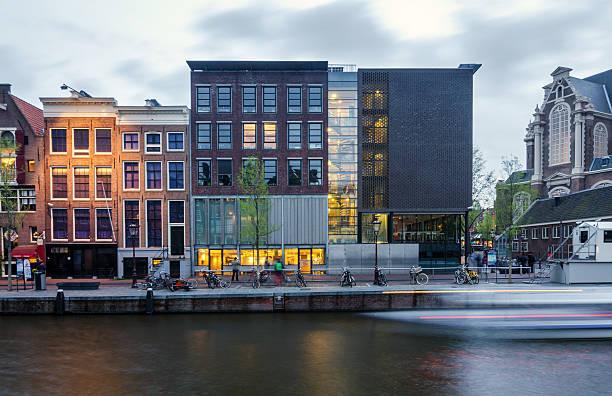 tourist visit anne frank house in amsterdam, - westerkerk stockfoto's en -beelden