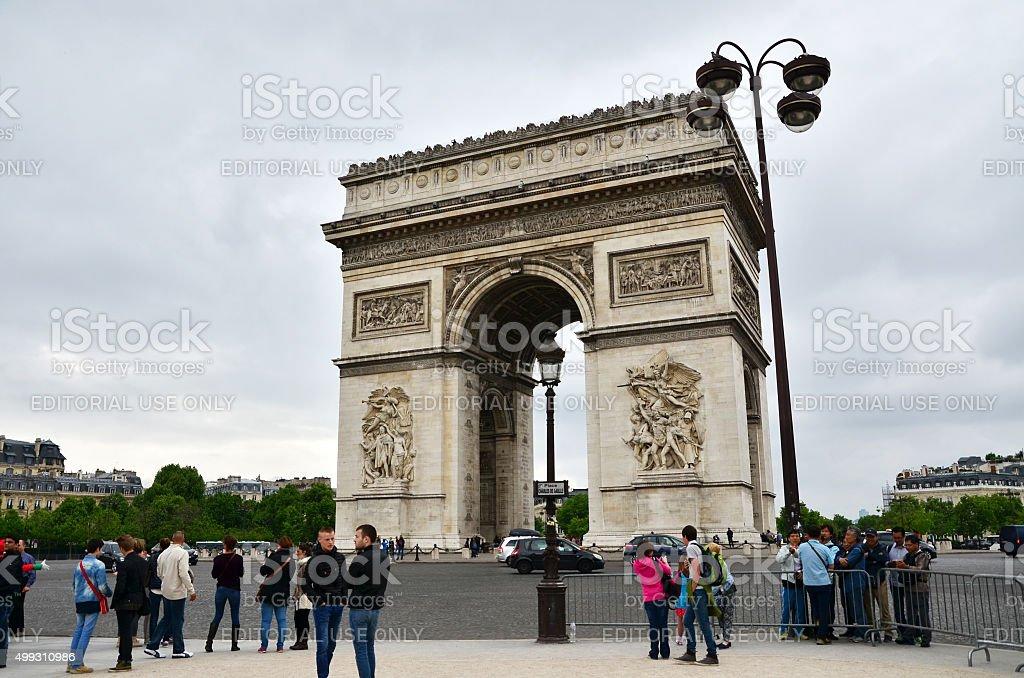 Tourist visit Arc de Triomphe de l'Etoile in Paris. stock photo