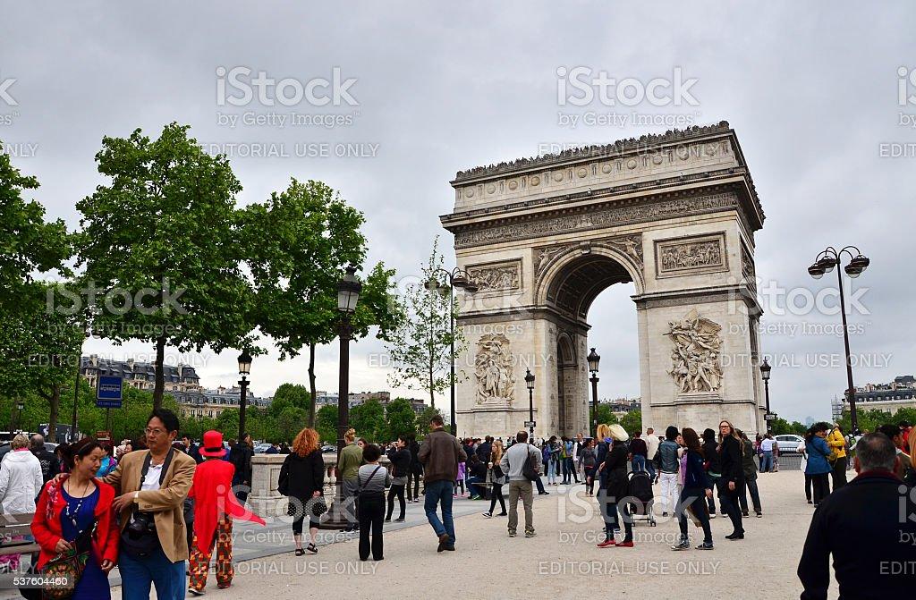 Tourist visit Arc de Triomphe de l'Etoile in Paris stock photo