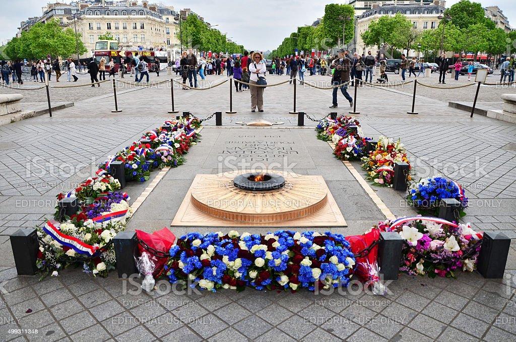 Tourist visit Tomb of Soldier beneath the Arc de Triomphe stock photo