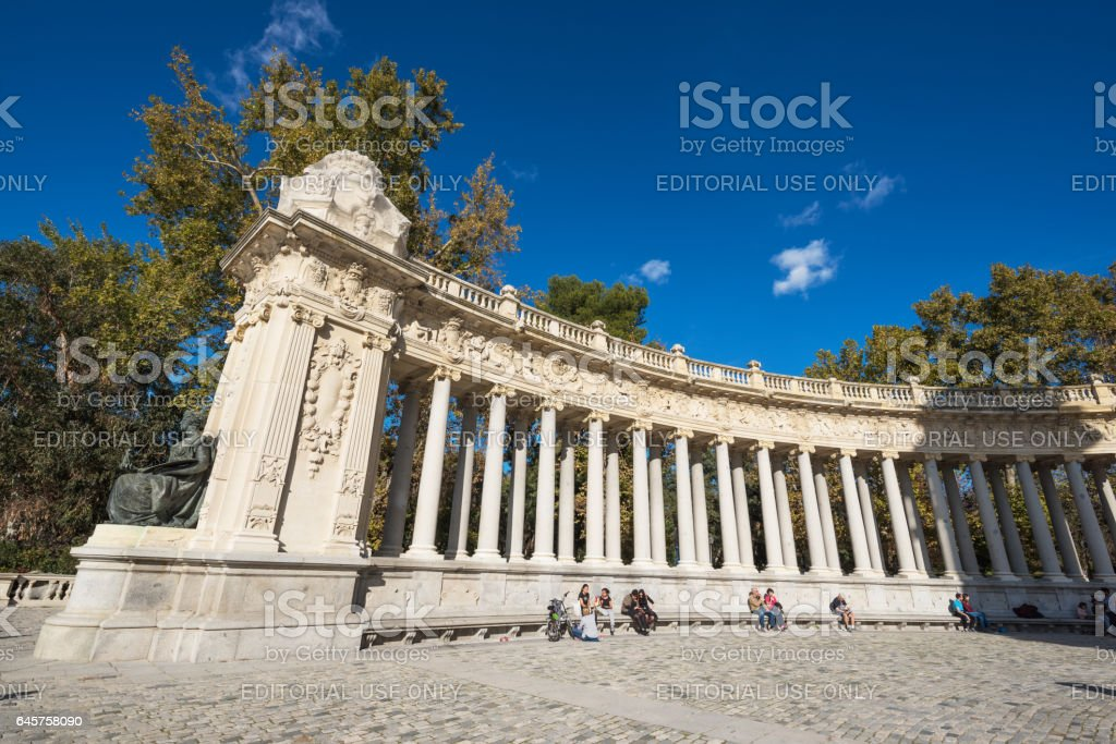 Tourist visiting Alfonso XII monument in Retiro park, Madrid, Spain. stock photo