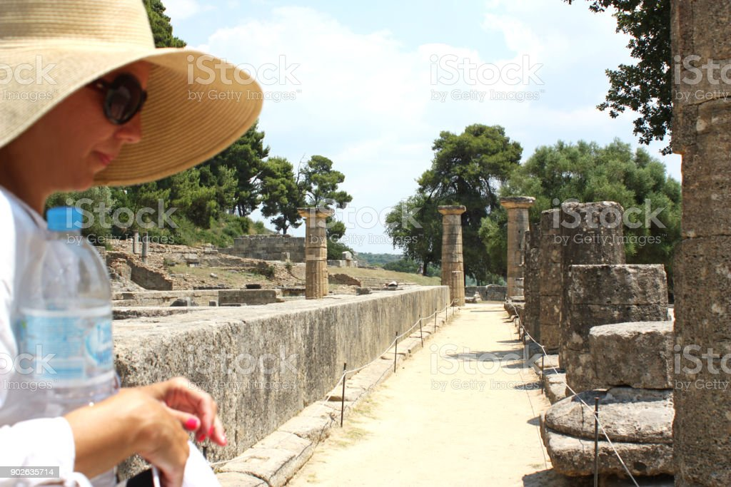 Tourist visiting ancient Olympia, Greece stock photo