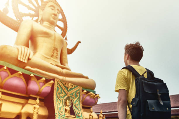 Tourist Visiting Asian Temple Wat Phra Yai and Big Buddha Tourist Visiting Asian Temple Wat Phra Yai and Big Buddha. Koh Samui. Thailand bodhisattva stock pictures, royalty-free photos & images