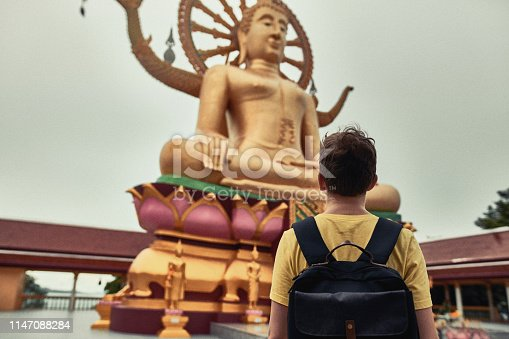 Tourist Visiting Asian Temple Wat Phra Yai and Big Buddha. Koh Samui. Thailand