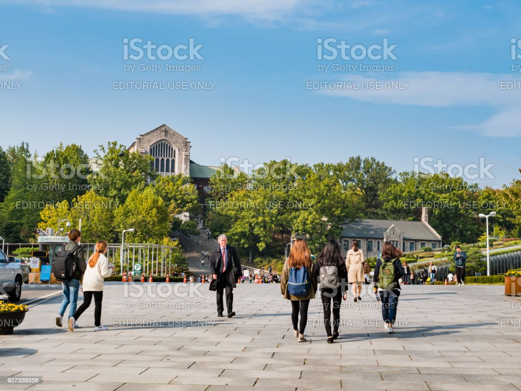 Tourist visiting Ehwa womans university. This is the first women university in South Korea. Seoul, South Korea - October 16, 2017: Tourist visiting Ehwa womans university. This is the first women university in South Korea. Adult Stock Photo