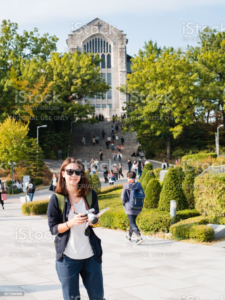 Tourist visiting Ehwa womans university. This is the first women university in South Korea. - Royalty-free Adult Stock Photo