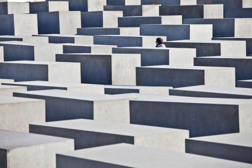 Tourist Visiting Holocaust Memorial in Berlin, Germany