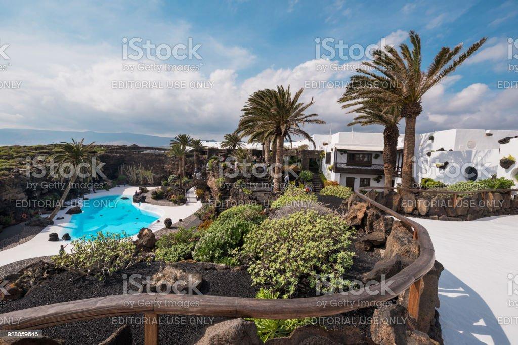 Tourist visiting landmark Jameos del Agua, Lanzarote, Canary islands, Spain. stock photo