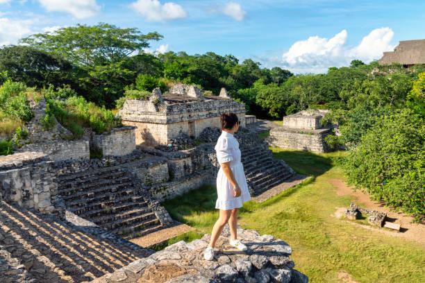 Tourist visiting Mayan ruins in Yucatan, Mexico stock photo