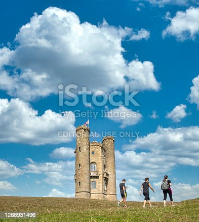 Tourist visiting the famous Broadway Tower on a lovely Summers day, sitting high in the Cotswold landsacpe. Broadway Tower is a folly on Broadway Hill, near the large village of Broadway and is the second-highest point of the Cotswolds (312m) after Cleeve Hill  (330m)