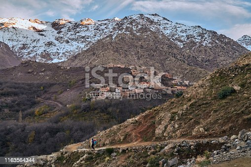 istock Tourist walking on a touristic path in High Atlas Mountains 1163564344