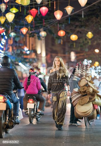 istock Tourist walking through downtown Old Quarter Hanoi at Night, Vietnam 689463052