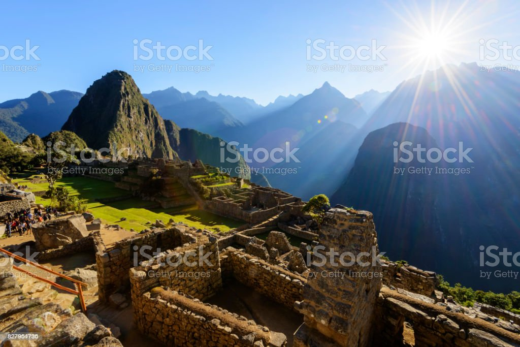 Tourist walking through Machu Picchu in the early morning. stock photo
