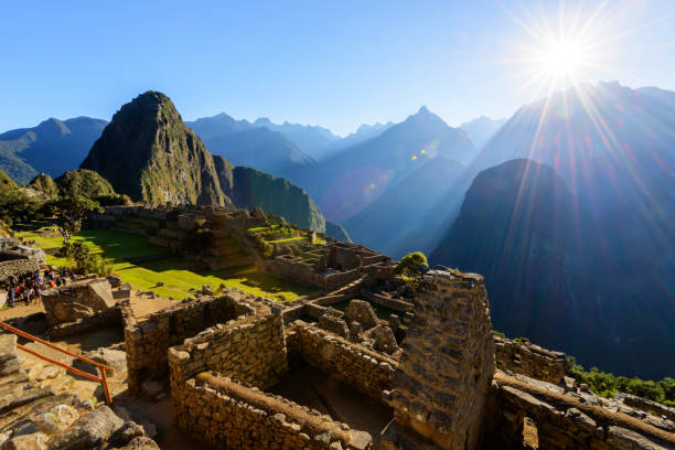 Tourist walking through Machu Picchu in the early morning. stock photo