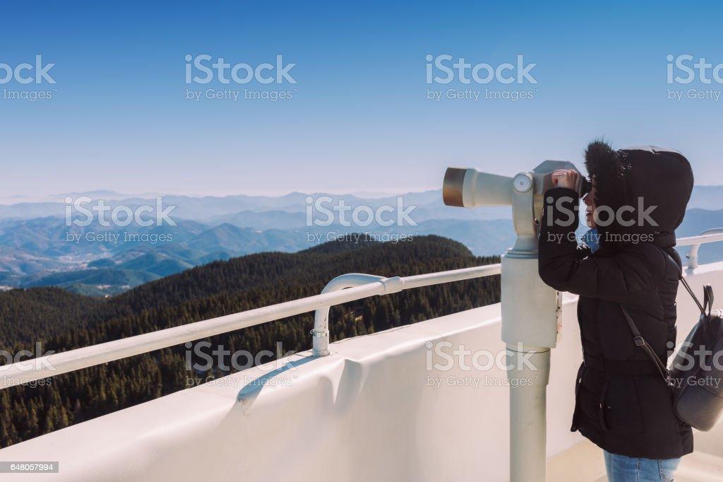 Tourist watching through binocular stock photo