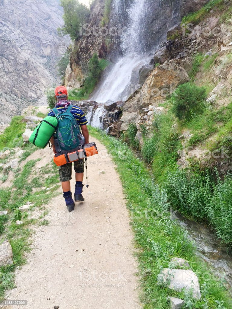 A tourist wearing backpack and enjoying the nature.