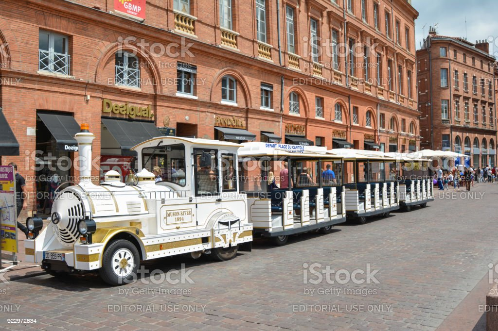 Tourist white train waiting for tourists to depart stock photo