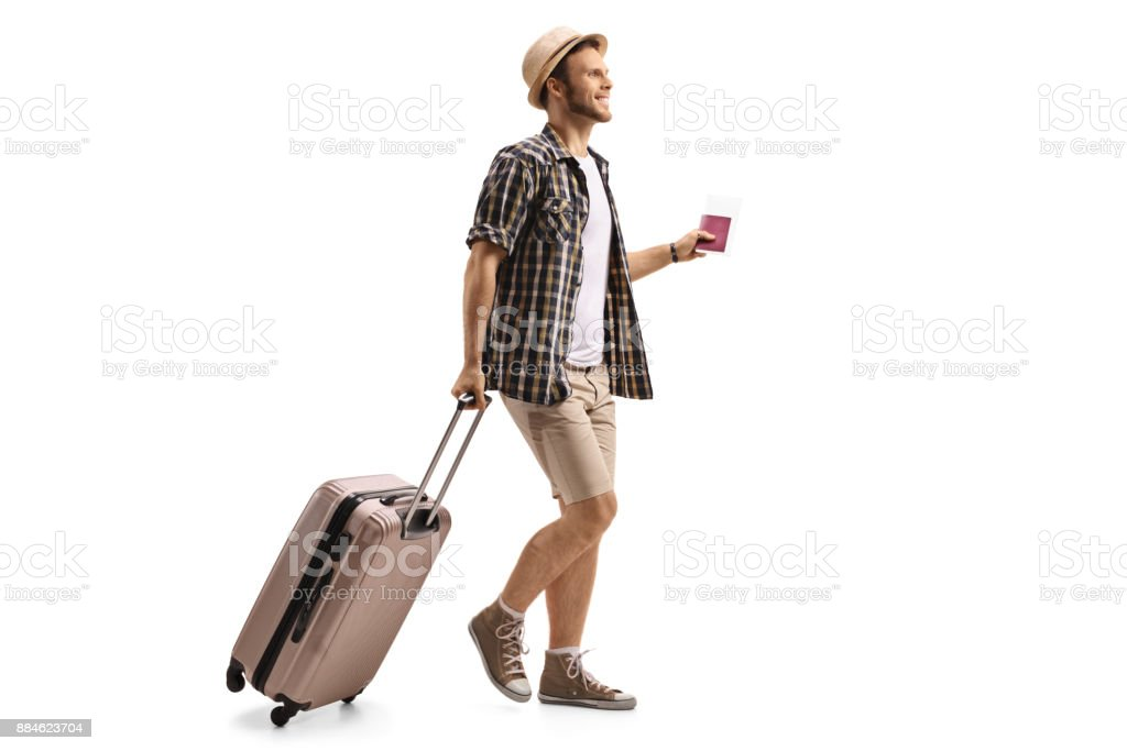 Tourist with a passport and a suitcase walking stock photo
