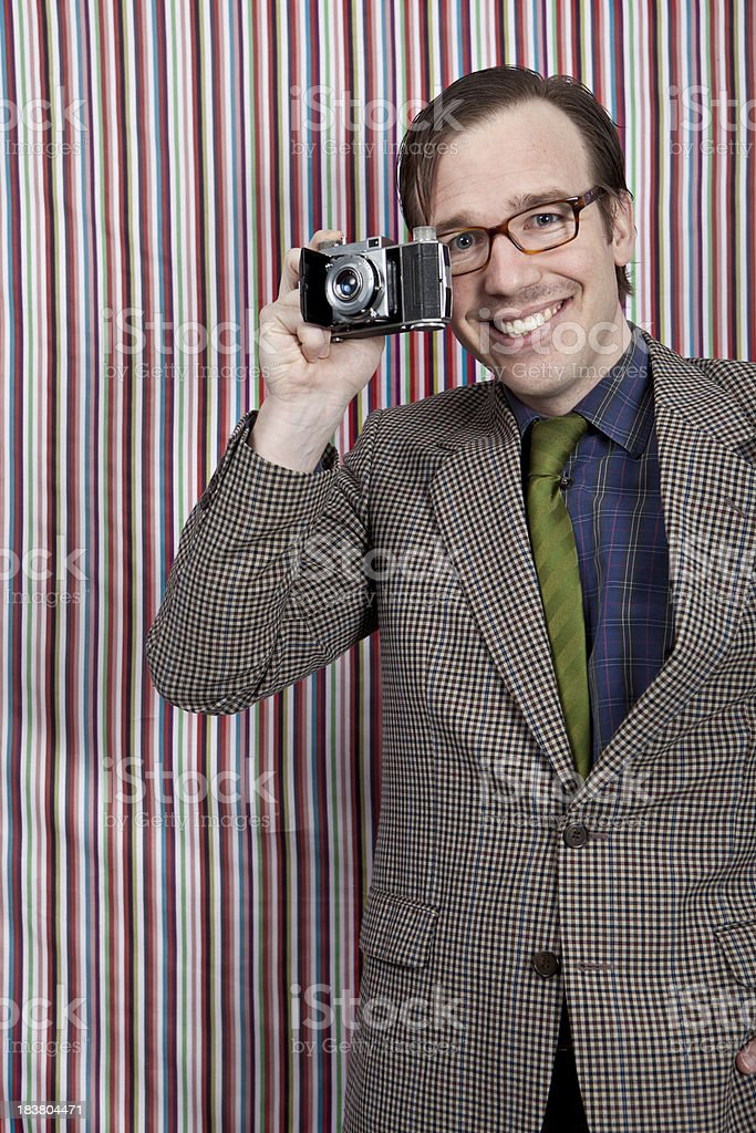 Tourist with a small vintage camera royalty-free stock photo