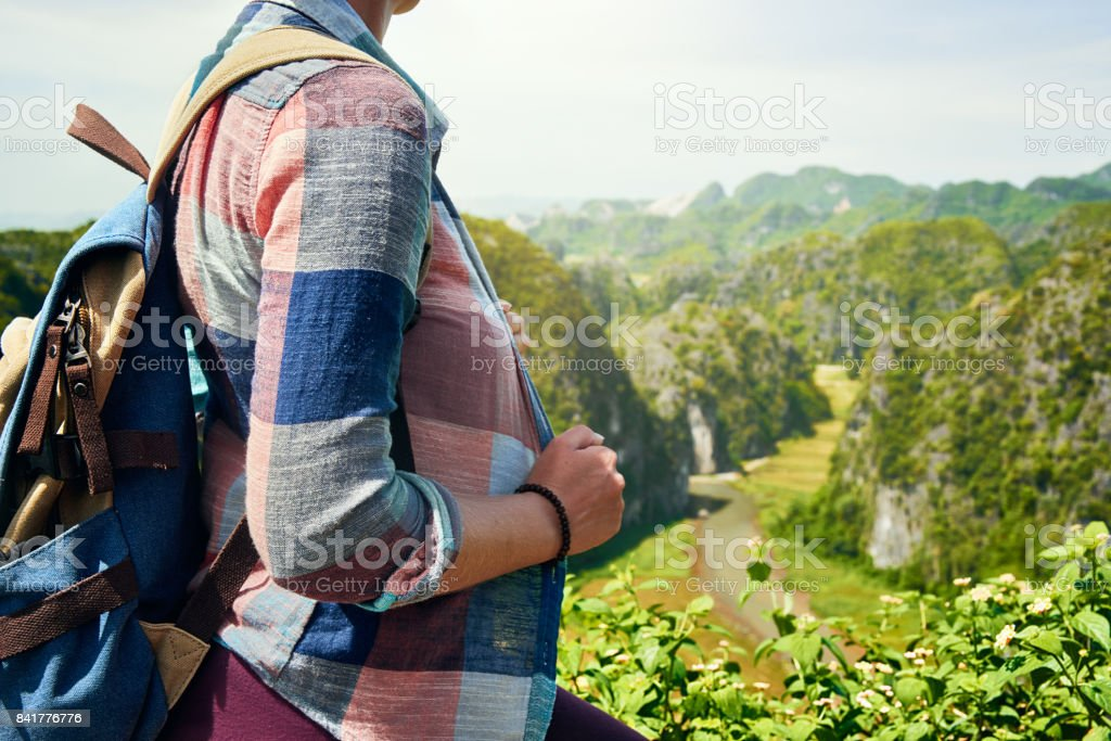 tourist with backpack enjoying river and valley view stock photo