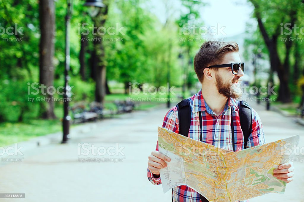 tourist with beard laughing and holding a map stock photo