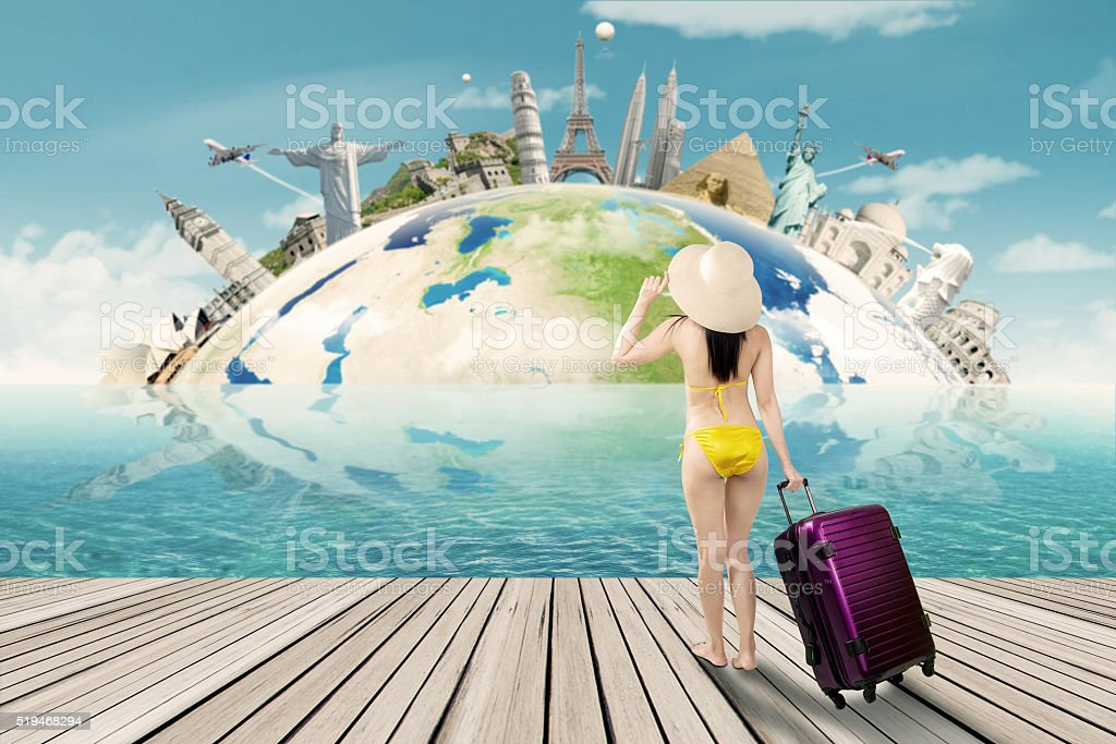 Tourist with bikini and the world landmark stock photo