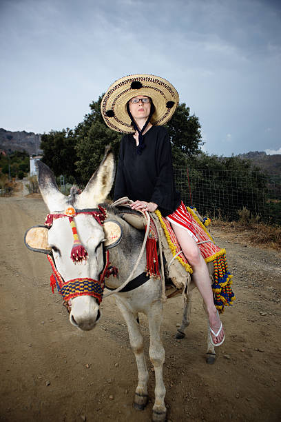 Woman Riding Donkey Stock Photos, Pictures & Royalty-Free