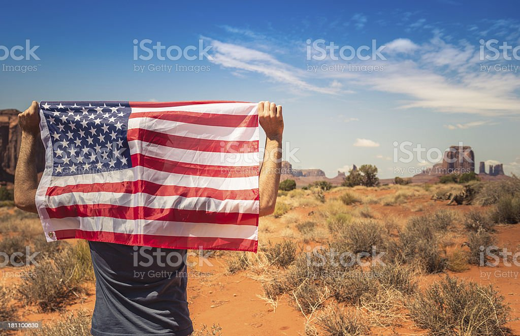 Tourist with flag on Monument valley National park stock photo