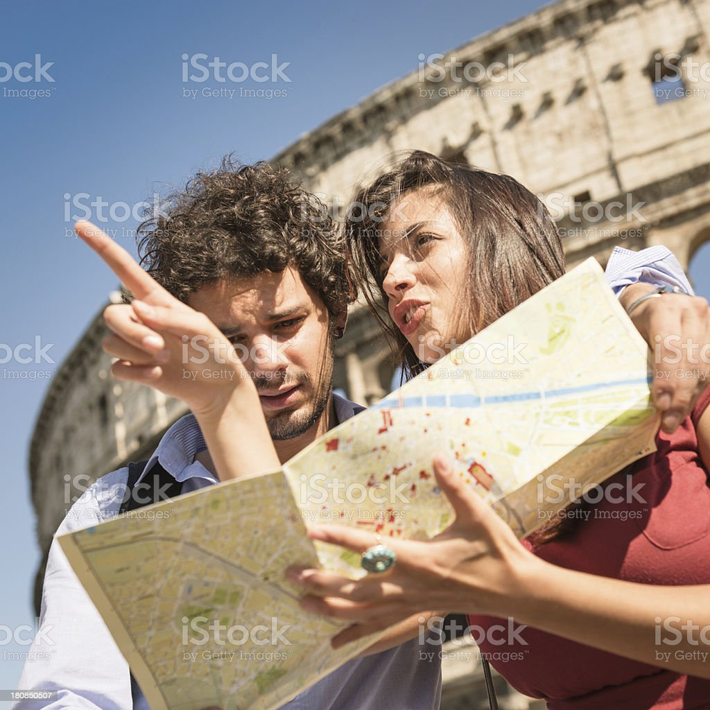 tourist with map at rome - coliseum royalty-free stock photo
