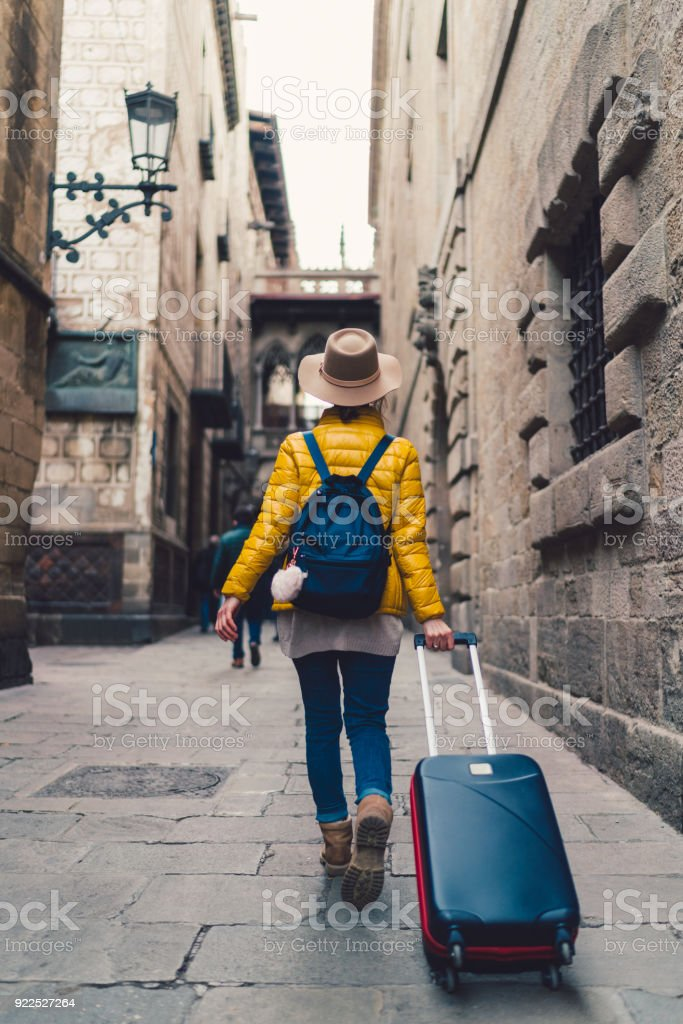Tourist with suitcase just arrived in Barcelona stock photo