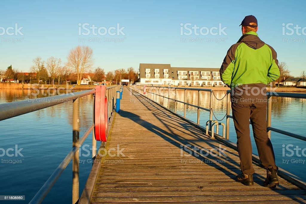 Tourist wlk on wharf construction above  sea to harbor. stock photo
