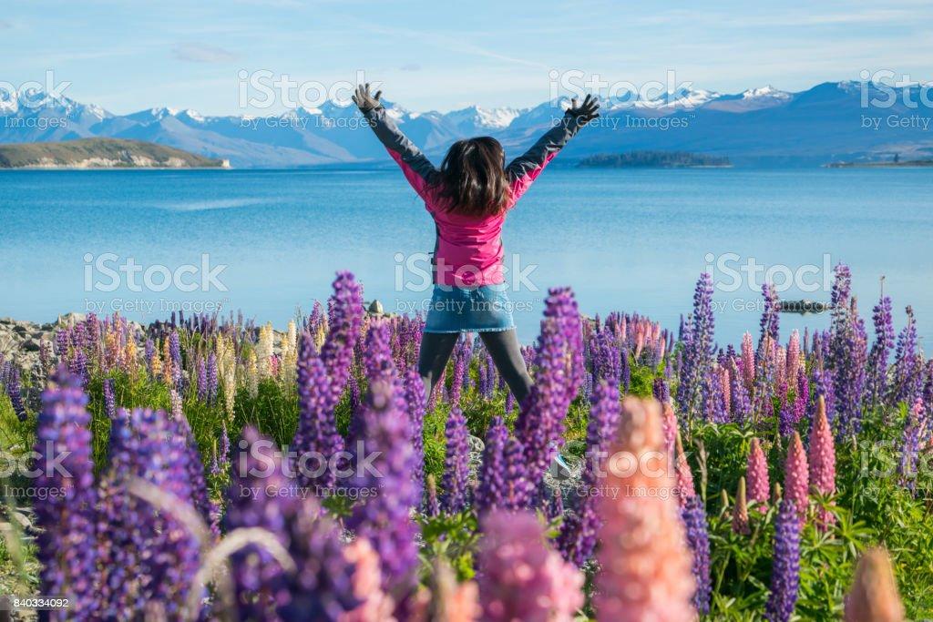 Tourist woman at lake Tekapo, New Zealand stock photo