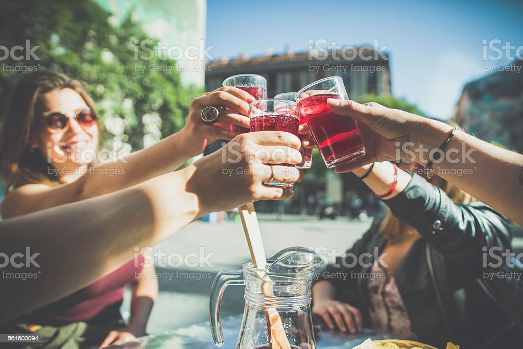 Tourist woman drinking cocktails in Madrid stock photo