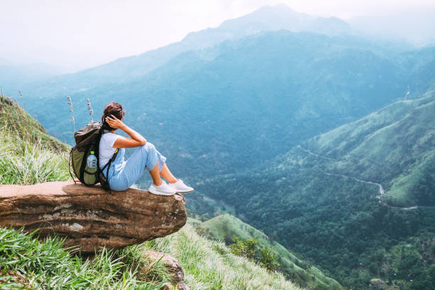 Tourist woman enjoy with beautiful view on mountains and valley in Ella, Sri Lanka, Little Adam Peak stock photo