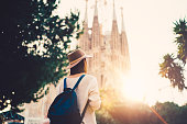 Rear view of woman admiring Barcelona on sunset