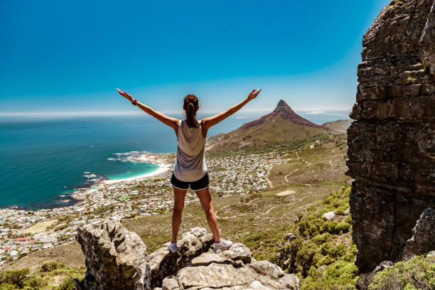 Tourist woman hiking Table Mountain looking at Lion's Head, Cape Town, South Africa stock photo