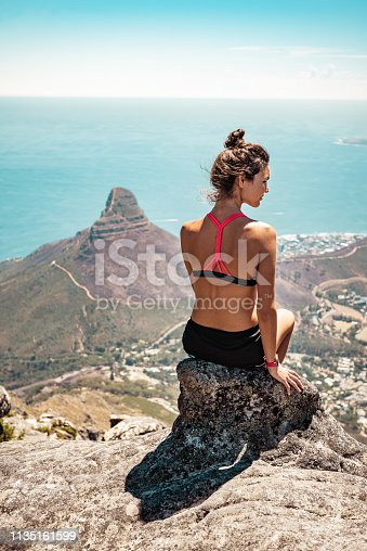 Tourist woman hiking Table Mountain looking at Lion's Head, Cape Town, South Africa