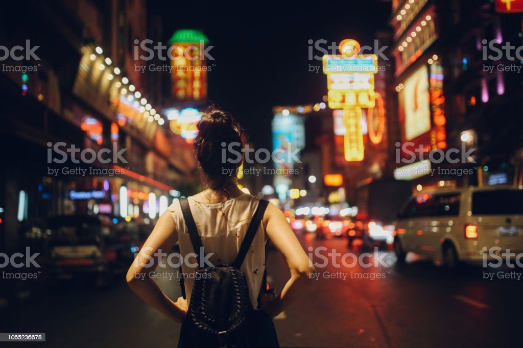Tourist woman in Bangkok at night stock photo