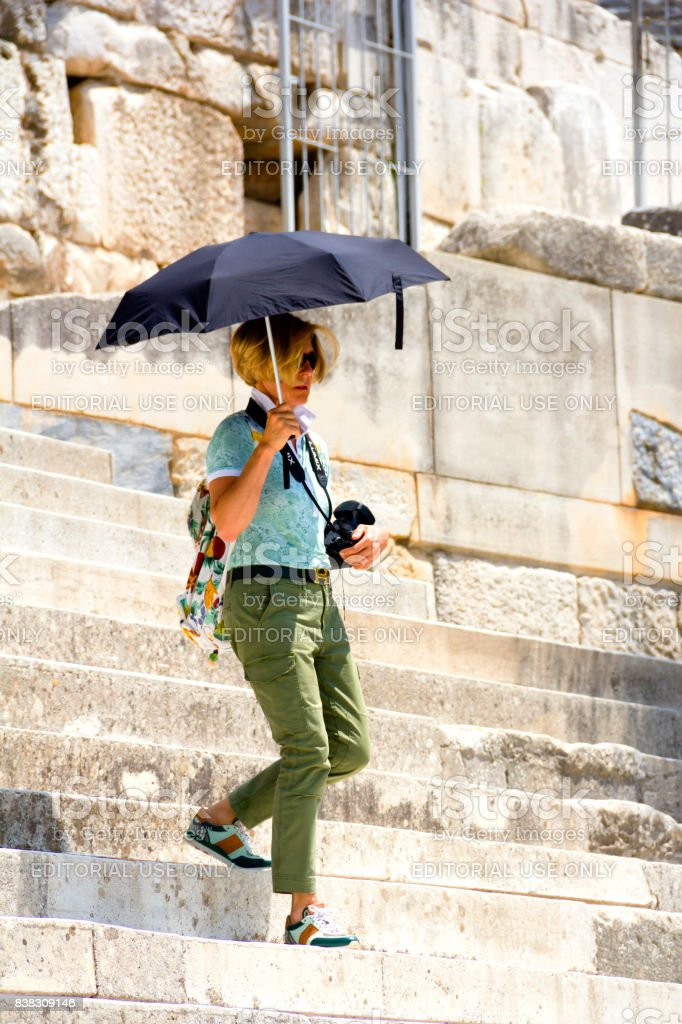 A Tourist Woman In Ephesus With Her Umbrella And Camera stock photo