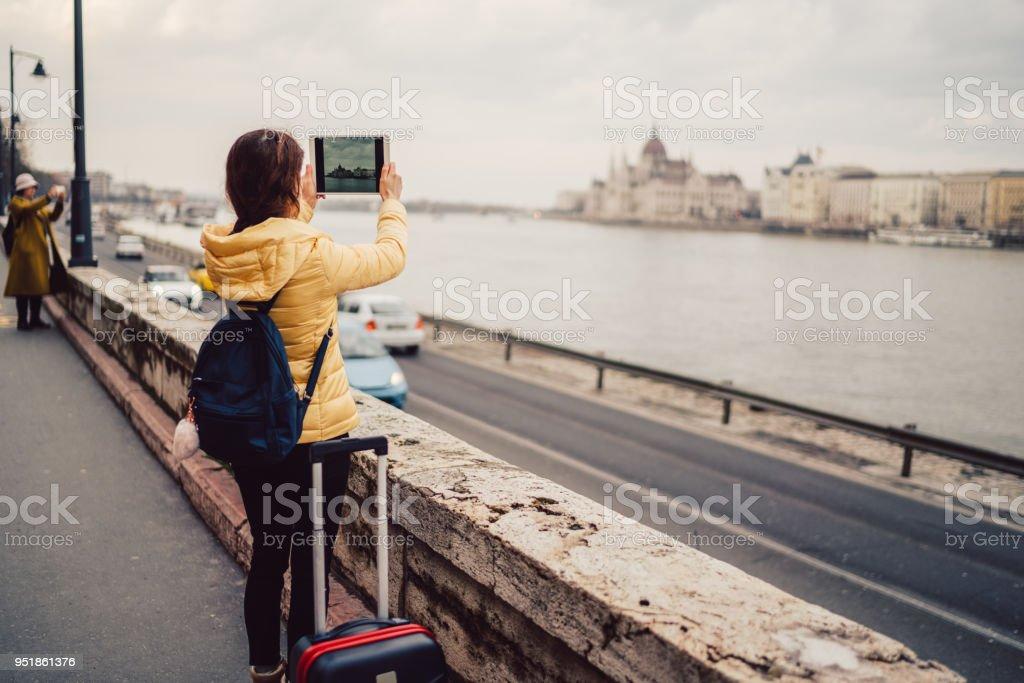 Tourist woman in Europe taking photos stock photo